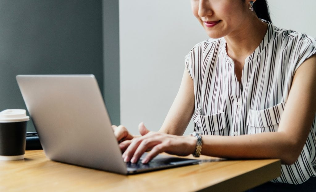 woman alone behind laptop